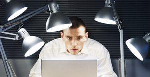 Desperate Man working on his laptop.   Original Filename: 84859487.jpg